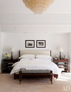 In the neutral master bedroom, Rose Tarlow Melrose House side tables flank the bed, which is upholstered in a Holly Hunt leather | http://archdigest.com