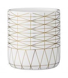 Set de 3 maceteros de cerámica blancos con líneas doradas.