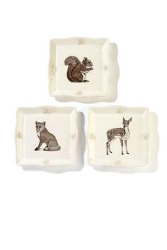 What a lovely12 pc luncheon or dessert set for the wildlife lover. Can be used as one set or divided up as three different gifts . each plate/cup and comes with a fox  a squirrel or a deer on them and each has a matching ceramic ornament of the same animal.. Imagine your lunch or dessert table set with a plate  a cup with a lid topped with a pinecone and the ornament used as a napkin ring Plates featurescalloped edges adorned with pine cones ( 3pc) Cups feature a lid for keeping beverages…