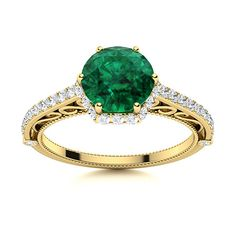 The dazzling halo design is encrusted within a skillfully crafted stylish band with delicate filigree. This unique Emerald ring in 14k Yellow Gold gives a vintage twist to a modern design. Natural Emerald Rings, Love Ring, Halo Rings, Halo Diamond, Shades Of Green, Vintage Rings, Ring Designs, Filigree, Modern Design