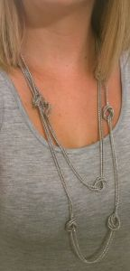I like longer necklaces and think this is adorable! Love the silver tone and the knots. I can see this being used to dress up a boyfriend T and wearing it to work.