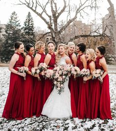 Deep red bridesmaid dresses make a winter wedding oh-so festive ❄️ | : @janelle.sutton