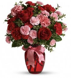 Seductive mix of carnations, roses, and more!  Dance with me is a sweet and impressive floral arrangement.