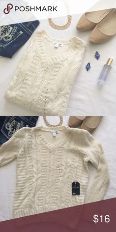 """NWT St. John's Bay cream cable knit sweater Perfect fall staple! This versatile cream sweater can be worn so many ways - leggings, jeans, booties, use your imagination!! This item is brand new with the tags and size sticker attached. Measurements: bust 19"""", length 23"""", arm 25"""" - this looks like it could work for a medium, too. St. John's Bay Sweaters Crew & Scoop Necks"""