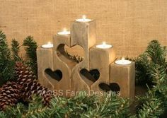 chunky wooden candle holder with cutout hearts