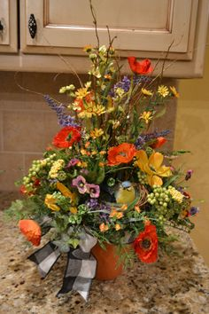 Colorful Spring Bird Nest Arrangement by kristenscreations on Etsy, $52.00