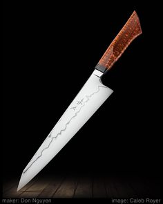 "maker: Don Nguyen website: donnguyenknives.com ""W2 gyuto with a hamon and kiritsuke-style tip. The handle is a new design of mine made from G10 and snakewood. It's a pretty wild kitchen knife in that it starts out really beefy towards the heel and tapers to a really thin tip."" Blade length: 10 1/8"" Overall length: 15 1/4""   #calebroyerphotography #knife #knifemaking #knives #customknives #handmadeknives #knifecommunity #handmade #knifeart #knifepics #imagecalebroyer #steel #edge #sharp…"