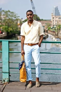 .A well-assembled look.  Neutral shoes are a good match with the pastels.  A faint yellow oxford short looks nice tucked in light blue rolled-up pants with caramel belt, and help bring out the warmth in his skin tone.  The bold mustard bag is also a nice touch (and a good move for that to be the only bold color).