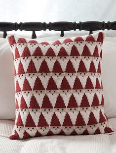 This knit Santa pillow from Knit Picks is totally adorable and looks like it would be a really fun color knitting project. The triangular Santas stack on top of each other into a fun allover patter…