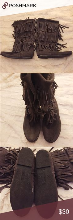 Minnetonka Suede Gray Fringe Moccasin Boots Fun dark gray Minnetonka fringe boots! These boots are in excellent condition and very comfortable, only worn a couple times! Boots come up to about mid calf. 🌟Open to reasonable offers!🌟 Minnetonka Shoes Winter & Rain Boots