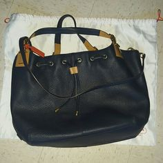 100% auth Coach XL tote Excellent condition. Soft saffiano leather. Xl. Clean inside and out. Only used an handful of times.  Received many compliments. Shoulder strap and dustbag included. Navy blue. I paid $598. Selling at a great price so it moves faster.  Need to empty out my closet! ! Coach Bags Totes