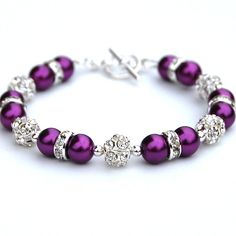 Purple Pearl Rhinestone Bracelet, Bridesmaid Gifts, Bridal Party, Gift for Her, Pansy Purple Beaded Bracelet I have strung 8mm glass pearls with 8mm rhinestone fireballs and rondelles. The bracelet measures 7.5/19cm and is finished with a silver plate toggle clasp. If you need the length
