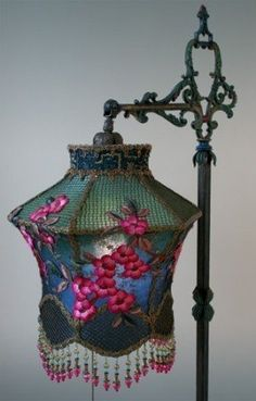Antique metallic lace lamp.  Beads are for more than jewelry