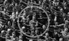 Courage.     This World War II photograph captures the courage of August Landmesser who made history by refusing to perform the Nazi salute.