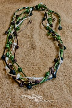 Macrame necklace green/brown tones  corals made of by Splatane, €15.00