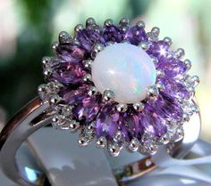 Sterling Silver Coober Pedy Opal Solitaire w/Halo of Amethyst & White Topaz. Brand New! Genuine & All Natural Gemstones! Not Lab Created! The Opal is October's Birthstone. Amethyst is February's Birthstone. Totally natural Coober Pedy Opal, beautifully complimented by a halo of sparkling White Topaz & enchanting Amethyst in an alluring Solid 925 Sterling Silver Ring. Visit my eBay store for this & more beautiful genuine gemstone jewelry. http://stores.ebay.com/HM-Fine-Jewelry-And-More