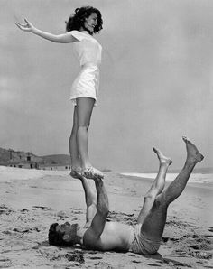 Date 1946. Ava Gardner and Burt Lancaster. Beach acro-yoga