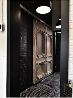 black zenith and 19th century elegance make the perfect pair in industrial entry