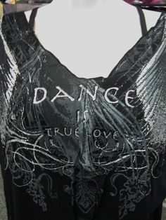 """Capezio's new """"Dance is True Love"""" Tunic. 20% off this week. FB orders only!! Comes in Black/Eggplant. Full pictures on our page."""