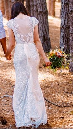 Alexandra is a stunning gown with a V neck, sheer capped sleeves and a fishtail train. It is heavily embroidered with floral motives and sequins an. Used Wedding Dresses, Bridal Dresses, Karen Willis Holmes, Ever After, Sequins, Gowns, Bride, Celebrities, Floral