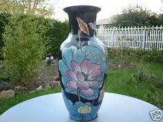 GRAND VASE EN PORCELAINE DECOR FLEURS MULTICOLORES LIMOGES?