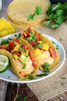 Healthy and quick coconut lime shrimp tacos sweetened with coconut and topped with a sweet and spicy salsa of mango, red pepper and avocado!