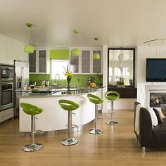 cool corner kitchen idea.  Like the pops of green.  Like the slim design of the bar stools.