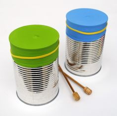 Make drums with balloons, tin cans, and chopsticks