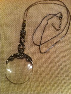 Vintage magnifying glass pendant                                                                                                                                                                                 More