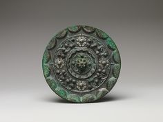 Mirror with Constellation and Cloud Design, Western Han dynasty (206 B.C.–A.D. 9). China. Bronze. The Metropolitan Museum of Art, New York. Purchase, Gift of Elizabeth V. Cockcroft, by exchange, 2008 (2008.40). #CosmicWonders
