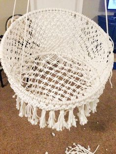 DIY Macrame Hanging Seat. I've always wanted a chair hanging from my ceiling, but they're so expensive to buy.
