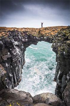 Beautiful natural bridge at the Anastarpi coastline in Iceland