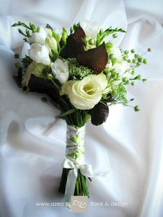 Hand Tied Wedding Bouquet Comprised Of: White Lisianthus, White Freesia, Burgundy Foliage