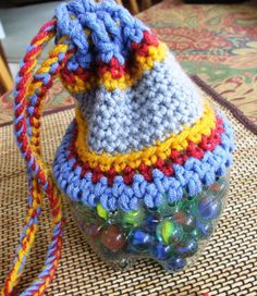 Cute little bag for marbles or other small objects, and it recycles a plastic bottle!