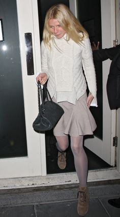 Gwyneth used a white cable-knit sweater, taupe circle skirt, and tights to maximum effect; it's a basic color combo, minimally accessorized and perfectly executed.
