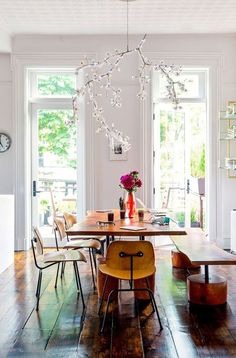 Like the organic shape of the table and bench paired with the sleek lines of the chairs.