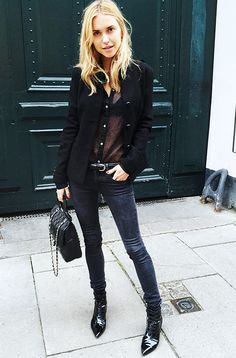 Pernille Teisbaek of Look De Pernille wearing head to toe black with black patent boots and a sheer black button down shirt