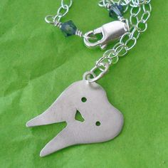 Smiling Tooth Sterling Silver Necklace.  via Etsy.