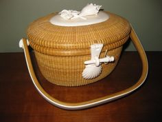 """Michael Kane   Nantucket Friendship Basket  with ivory scallop shell latch and peg, ivory scallop shell knobs;  top with applied conch shell and blossom.  Signed upon the base, """"Made by Michael Kane, Nantucket Island""""  Rafael Osona Auctions"""