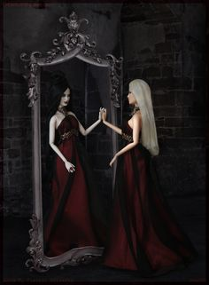 The enchanted mirror revealed her true form.  In this photo: Haunted Beauty Vampire™ Barbie® doll and Barbie® Basics Model No. 14 Collection...