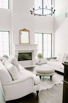 New Build Modern Farmhouse Home Tour with Holly Christian Hayes - Living Room - Minimalist Design - Minimal Home Design - Home Decor - Interior Design - White Sofas - Cow Hide Sofa - European Farmhouse - Black Framed Windows with White Walls
