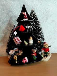 christmas tree shaped shelf unit.  table top and floor