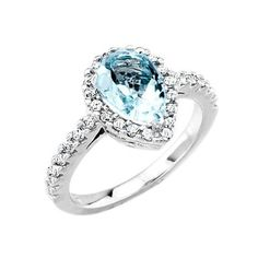 White Gold Pear Aquamarine Diamond Engagement Ring - One of the most beautiful gemstone colors ever created makes it one of our favorites with this dashing White Gold Pear Aquamarine Diamond Engagement Ring stamped in 10k White Gold placed within a Prong setting featuring a Pear cut center stone with White Round cut accent stones on the mount & shank. The White Gold Pear Aquamarine Diamond Engagement Ring has a total gem weight of 1.33 carats with an I1 in clarity. #unusualengagementrings