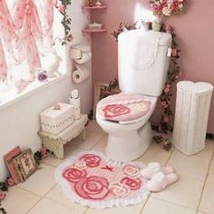 shabby chic bathroom toilet in pink and white with flowers
