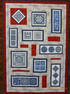 """Jan Hinshaw, quilted wallhanging I made using your book """"Chinese Indigo Designs"""".  I printed the designs on fabric using an inkjet printer, then designed the quilt, machine pieced,  appliqued, and machine quilted it.     I loved working with the beautiful indigo designs."""