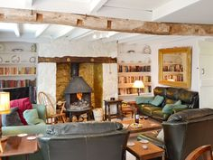 This traditional Welsh barn offers beams, exposed stonework and a lovely fireplace with a wood burner for cosy evenings. Welsh Cottage, Cosy Lounge, Brick Interior, Bedroom Windows, Open Fires, Wood Burner, Interior Decorating, Decorating Ideas, Game Room