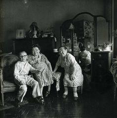 Diane Arbus – Russian midget friends in a living room on 100th Street, N.Y.C., 1963