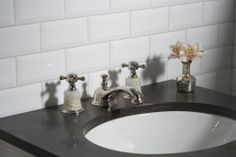 """ANN SACKS Arden 3"""" x 6"""" beveled ceramic field in white with @Kallista Plumbing precut marble top in bleu de chine and amedee basin set with cross handles in honey onyx"""