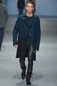 Owercoat wool in blue marine. Black Leather pants. Boots.  Costume National Homme Men's RTW Fall 2014