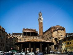 :: DISCOVER #SIENA :: Piazza del mercato Behind the Palazzo Pubblico and the Campo lies below the big Piazza del Mercato, open on one side and closed on the other by beautiful medieval houses.